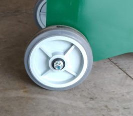 Wheels attached to a green metal base.