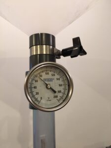 pipe with temperature gauge attached.